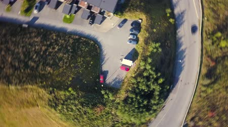 trondheim : Aerial Capture of circular movement in Trondheim, Norway, topdown view on Parking Lot - Sunny Summer Day