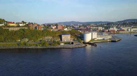 trondheim : Aerial Capture of Trondheim City, Norway - Sunny Summer Day, Starting Movement From the Fjord to City, over Water - Sunset Colours