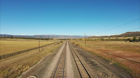 foothills : Empty railroad tracks leading to Colorado Rocky Mountain foothills Stock Footage