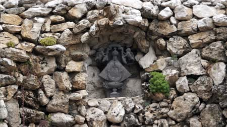 hacienda : Chapel stone ruin virgin close up Stock Footage