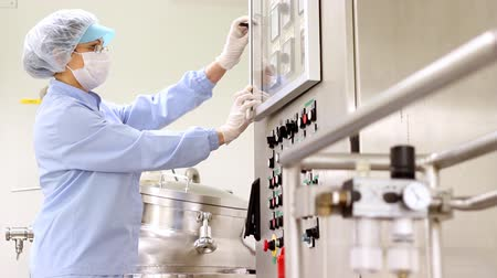 pharmaceuticals : Preparing machine for work in pharmaceutical factory. HD 1080p. Stock Footage