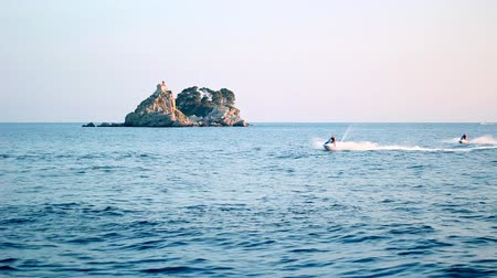 Черногория : Two men riding on jet skis. HD 1080i.