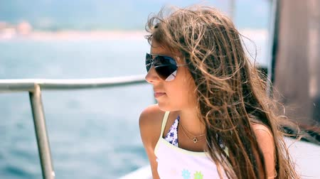 vacation destination : Outdoor portrait of beautiful young girl with wind in her long hair.