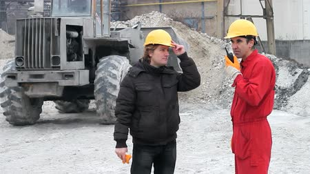 munkás : Construction workers and bulldozer on the construction site. HD 1080i.  Stock mozgókép