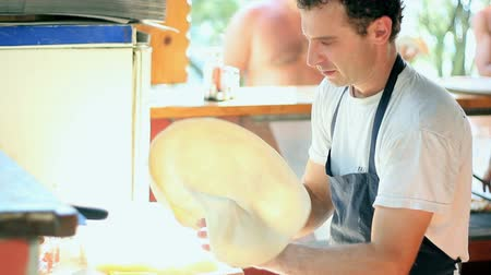 chef cooking : Montage of clips showing skillful chef preparing a pizza. HD 1080i. Stock Footage