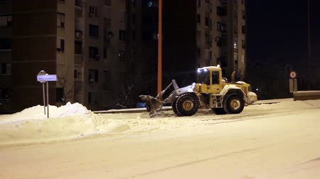 deep snow : Snow removal machine grabs snow from the road. HD1080p.