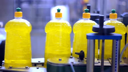 cleaning products : Bottles of liquid detergent moving along a conveyor belt. Stock Footage