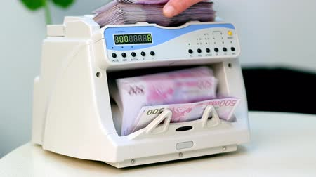 sucessful : An electronic money counter processing Euro 500 bills. HD 1080p.