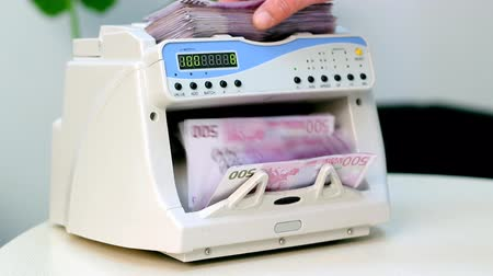 sucessful : Montage of clips showing electronic money counter processing Euro 500 bills. HD 1080p.
