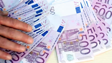 sucessful : Close-up of a hand and 500 Euro banknotes on the table. HD 1080p
