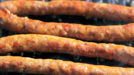 kiełbasa : Sausages on the barbecue grill. Selective focus. HD1080i.