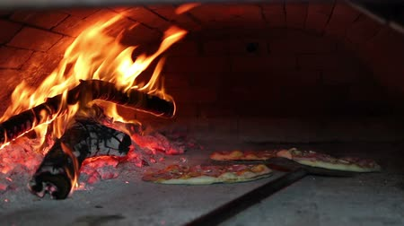 italian food : Pizza Baking in Wood Fired Oven Stock Footage