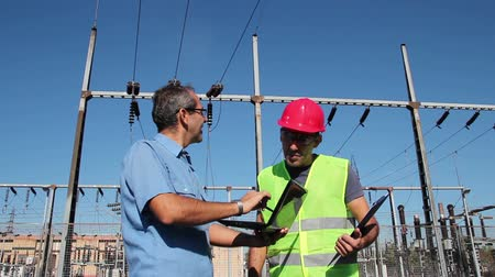 mühendislik : Engineer and Worker at Electrical Substation Stok Video