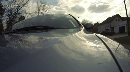 pneus : Exterior view of a car driving on a road Stock Footage
