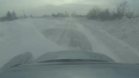 deep snow : Driving through a Deep Snowdrift Stock Footage