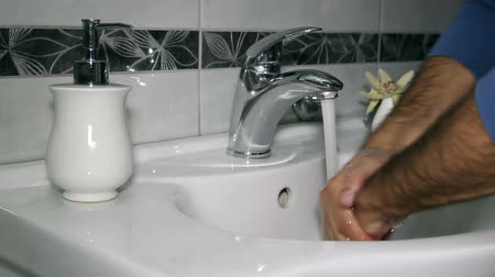 sujo : Washing of hands with soap under running water.