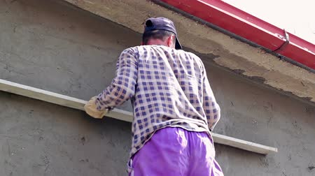 sıva : Construction Worker Leveling Cement Render