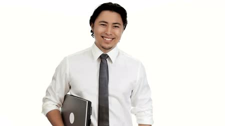 krawat : A handsome businessman in his 20s wearing a white shirt and grey tie, holding a laptop computer, working with a big smile on his face. White background.