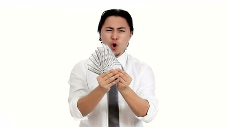 банк : Attractive businessman wearing a white shirt and tie. Holding a big fan of 100 dollar bills. Feeling great with a big smile. White background.