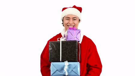 senhor : Young and attractive santa claus wearing a red santa suit and hat feeling great and happy. White background.