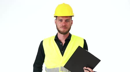 helmets : Attractive construction foreman in his 20s, wearing a yellow safety helmet with a yellow vest, holding a clipboard. White background.