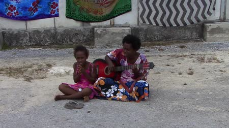 cook islanders : South Pacific Mother and Daughter Singing Stock Footage