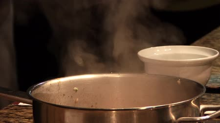 Steam rising above pans
