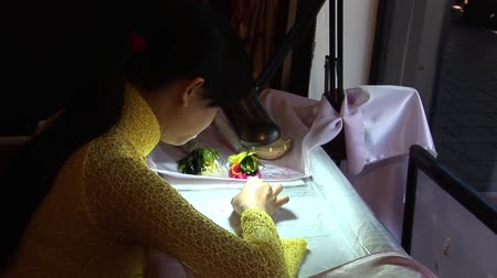 Vietnamese Women Sewing