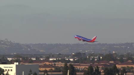 departing : plane taking off from San Diego
