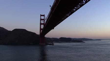 gates : Passing under the Golden Gate Bridge at Sunrise