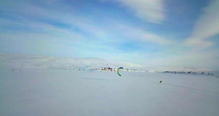 felülnézet : Aerial view of people snowkiting in tundra.