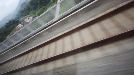 crosstie : Train track movement closeup. View   from fast moving train.