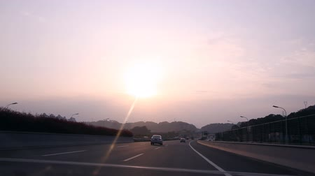 time journey : Timelapse highway driving footage: from the outdoors to tunnel at sunset, shot on a new road in Fuzhou, China.