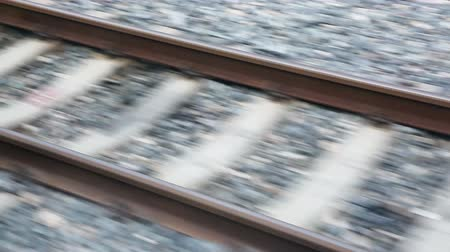stopa : Close view of railroad track moving at high speed