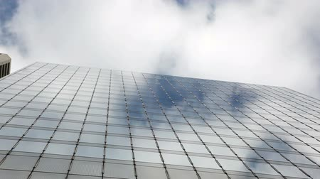 subir : Timelapse of clouds passing over office glass building,Central,Hongkong