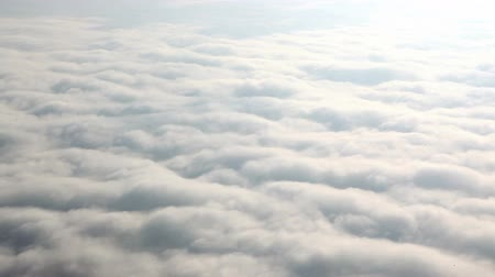 над : Flying above clouds