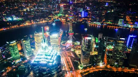 night scene : Aerial view of Shanghai Pudong at night from the observatory of Shanghai World Financial Center (SWFC). Many skyscrapers,including Jin Mao Tower (one of Chinas tallest buildings) and Oriental Pearl Tower.time lapse. Original Size 4k. Stock Footage