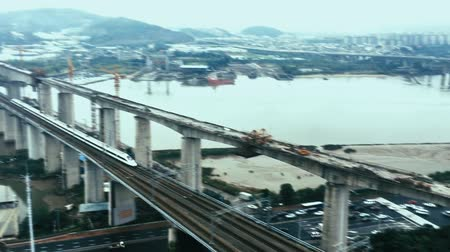 subúrbio : HD timelapse - Aerial view of a high-speed train crossing a complex road junction,Fuzhou,China Stock Footage