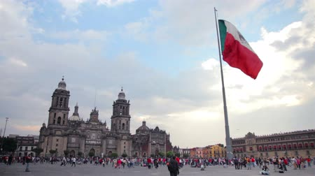 meksyk : Mexico City, 08Nov14. Metropolitan Cathedral and mexican flag. The building is one of most representative by catholics in Mexico. Most of mexicans are catholics. Also is an attractive tourist.