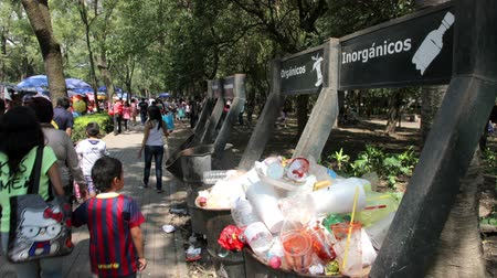 environmental awareness : Mexico City, Mexico-CIRCA July,2014: Dumpsters full garbage, people pass and drop their garbage. Garbage accumulation and awareness lack produce an important environmental and health problem in Mexico Stock Footage