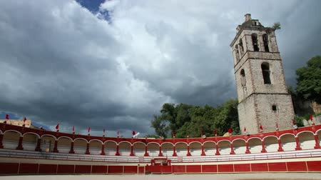 bull ring : Tlaxcala, Mexico-August 2014: TIME LAPSE-FULL SHOT. Bullring stands. Clouds are moving faster in the back.