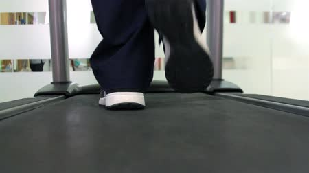 fried : Mexico, 2014: CLOSE UP-HANDHELD. Feet walking in a runner machine. Mexico has a big challenge about health care due the demand of better hospitals and medical attention.