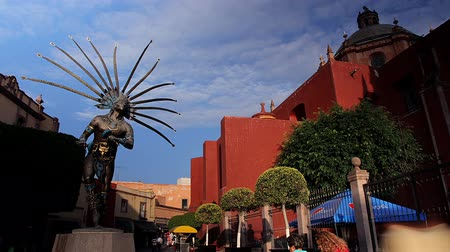 regional : TIME LAPSE. Statue of a dancing indian and facade of the church of San Francisco.