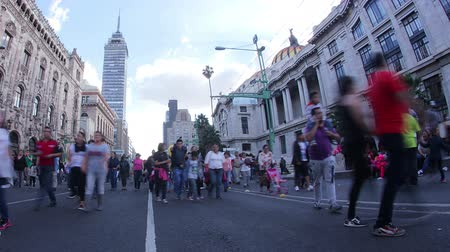 descobrir : MEXICO CITY, MEX 2016 (TIME LAPSE - ILLUSTRATIVE IMAGE). Crowds of people walking on the avenue Eje Central next to the Palace of Fine Arts, in the background you can see the Latin American Tower. Stock Footage