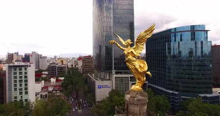 cdmx : Stunning aerial shot of the Angel de la Independencia (Independence Angel) monument surrounded by buildings in Mexico City. This atraction is the most famous and representative historic monuments.