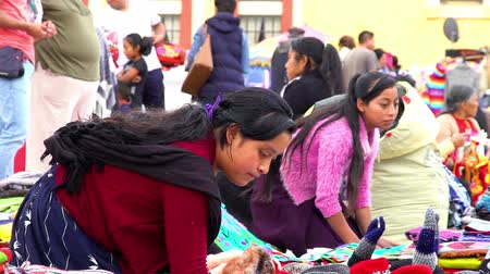 CHIAPAS, MEXICO-CIRCA AUGUST 2018: Merchant indigenous women offer traditional clothes to the tourists in the public square in San Cristobal de las Casas. TAKE 2 Stock mozgókép