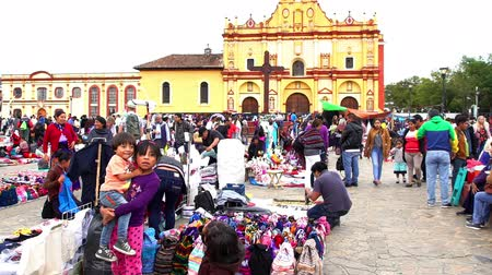 CHIAPAS, MEXICO-CIRCA AUGUST 2018 (TILT UP): Merchant indigenous women offer traditional clothes to the tourists in the public square in San Cristobal de las Casas. TAKE 4