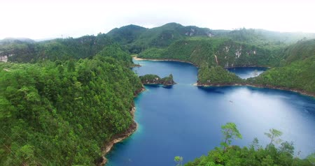 Chiapas, Mexico (DRONE VIEW). Stunning panoramic view of Cinco Lagos lagoons in the national park Montebello Lagoons. This place is one of the most beautiful attractive touristic in Chiapas. TAKE 1 Stock mozgókép