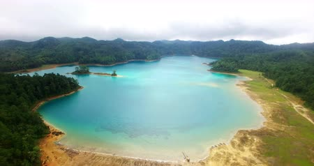 Chiapas, Mexico (DRONE VIEW). Stunning panoramic view of Montebello Lagoon in the national park Montebello Lagoons. This place is one of the most beautiful attractive touristic in Chiapas. TAKE 1 Stock mozgókép