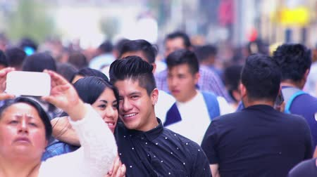 латинский : Mexico City, CIRCA June 2018 SLOW MOTION-TAKE 2: Crowd walking through street. In Mexico the population growing is a public problem due the high birth rates.
